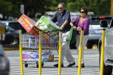 Customers leave a store with their purchases in Alexandria, Virginia, September 15, 2009. REUTERS/Jonathan Ernst