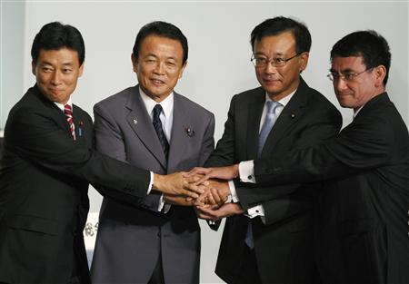 Liberal Democratic Party (LDP) lawmaker Sadakazu Tanigaki (2nd R) shakes hands with former prime minister Taro Aso (2nd L) and LDP presidential election candidates Taro Kono (R) and Yasutoshi Nishimura after Tanigaki was chosen as the party president during the LDP parliamentarian meeting at the party headquarters in Tokyo September 28, 2009. REUTERS/Issei Kato