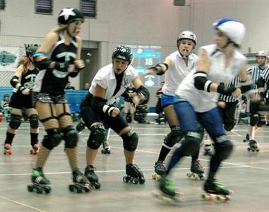 The Gainesville Roller Rebels compete against the Beach Brawl Skater Dolls at the Alachua County Fairgrounds, Gainesville, Florida, July 11, 2009. REUTERS/Dana John Hill/Handout