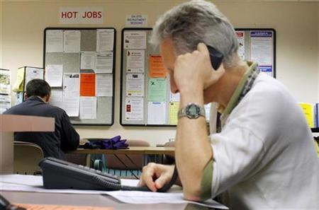 A job seeker makes a phone call to a potential employer at The Work Place, which provides comprehensive employment and career services in Boston, Massachusetts July 2, 2009. U.S. REUTERS/Brian Snyder