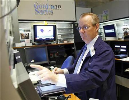 Dennis Maguire of Goldman Sachs works on the floor of the New York Stock Exchange, April 14, 2009. REUTERS/Chip East