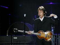 <p>Paul McCartney, formerly a member of The Beatles, performs with his band during a concert at CitiField in New York July 17, 2009. REUTERS/Shannon Stapleton</p>