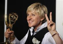 <p>Ellen Degeneres poses with her award for Outstanding Talk Show Host at the 35th Annual Daytime Emmy Awards at the Kodak theatre in Hollywood, California June 20, 2008. REUTERS/Phil McCarten</p>