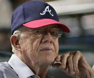 """<p>Бывший президент США Джимми Картер наблюдает за матчем MLB между """"Атланта Брейвз"""" и """"Нью-Йорк Янкиз"""" в Атланте 24 июня 2009 года. 1 октября 1924 года родился 39 президент США Джимми Картер. REUTERS/Tami Chappell</p>"""