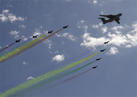 Planes from the Chinese People's Liberation Army (PLA) air force fly in formation during a massive parade to celebrate the 60th anniversary of the founding of the People's Republic of China, in Beijing October 1, 2009. REUTERS/Jason Lee