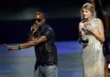 <p>Kanye West (L) interrupts the acceptance speech from best female video winner Taylor Swift (R) at the 2009 MTV Video Music Awards in New York, September 13, 2009. REUTERS/Gary Hershorn</p>