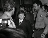 <p>Director Roman Polanski exits the Santa Monica Courthouse after a hearing in his sexual assault case in Santa Monica, California October 24, 1977. REUTERS/Chris Gulker/Herald Examiner Collection/Los Angeles Public Library/Files</p>