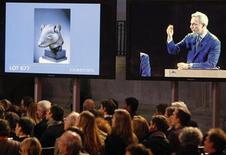 <p>Christie's auctions a bronze rat head made for the Zodiac fountain of the Emperor Qianlong's Summer Palace in China from the private art collection of late French fashion designer Yves Saint Laurent at the Grand Palais Museum in Paris in this February 25, 2009 file photo.REUTERS/Regis Duvignau/Files</p>