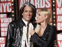 <p>Aerosmith's Joe Perry (L) and wife Billie Paulette Montgomery Perry arrive at the 2009 MTV Video Music Awards in New York, September 13, 2009. REUTERS/Eric Thayer</p>