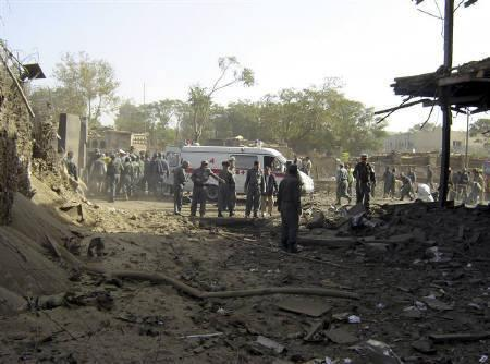 Afghan police investigate at the site of a blast in Kabul October 8, 2009. A large bomb exploded outside the Indian embassy in central Kabul on Thursday, killing 17 people and wounding 76. REUTERS/ Stringer