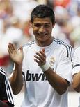 <p>Real Madrid's Cristiano Ronaldo applauds before his team's friendly soccer match against D.C. United in Landover, Maryland, August 9, 2009. REUTERS/Jason Reed</p>
