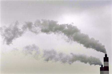 Smokes rise from chimneys of a coal-fired power station in Shanghai in this August 11, 2009 file photo. REUTERS/Aly Song