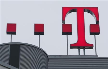 The sign of Deutsche Telekom AG is pictured at its headquarters in Bonn February 27, 2009. REUTERS/Ina Fassbender (GERMANY)