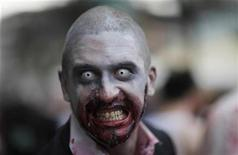 <p>A man made up to look like a zombie takes part in a zombie parade in Frankfurt, July 18, 2009. REUTERS/Johannes Eisele</p>