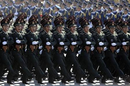 Army cadets shout slogans while marching in formation past Tiananmen Square during a parade to mark the 60th anniversary of the founding of the People's Republic of China, in Beijing October 1, 2009. REUTERS/Joe Chan