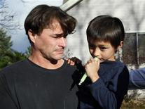 <p>Richard Heene reacts as he holds his son six-year-old Falcon Heene outside their house in Fort Collins, Colorado October 15, 2009. REUTERS/Rick Wilking</p>