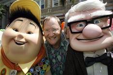 "<p>John Lasseter (C), chief creative officer at Pixar and Walt Disney Animation Studios and executive producer of ""Up"", poses with characters Russell (L) and Carl Fredricksen from the film during the film's premiere in Hollywood, California May 16, 2009. REUTERS/Fred Prouser</p>"