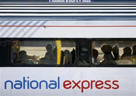 A National Express East Coast line train arrives at King's Cross station in London July 1, 2009. REUTERS/Luke MacGregor
