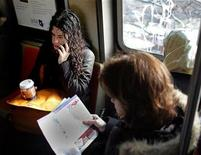 <p>A woman talks on her cell phone on a subway train in New York in this February 2, 2006 file photo. REUTERS/Seth Wenig</p>