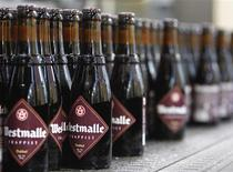 <p>Bottles of Westmalle beer are seen at the production line at Westmalle brewery September 22, 2009. Monks may no longer show up on the factory floor at Westmalle, but they ensure its marketing is earnest and have capped production at 120,000 hectolitres (12 million litres), making it the second largest Trappist brewer, after Chimay. Picture taken September 22, 2009. REUTERS/Yves Herman</p>