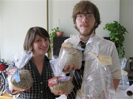 Erica Shea, left, and Stephen Valand quit their advertising jobs to start a business that sells 1-gallon home-brewing kits in New York City. Picture taken on September 29, 2009. REUTERS/Julie Gordon