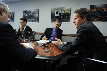 US Treasury Secretary Timothy Geithner (R) engages with reporters during the 2009 Reuters Washington Summit in Washington, October 20, 2009. REUTERS/Jonathan Ernst
