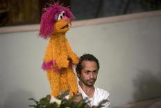 <p>Palestinian puppeteer Fadi Alghoul holds puppet Haneen as he prepares for the filming of a scene on the set of Shara'a Simsim in a studio in the West Bank city of Ramallah October 20, 2009. REUTERS/Fadi Arouri</p>