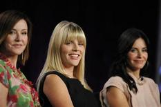 "<p>Cast members Christa Miller, Busy Philipps and Courteney Cox Arquette (L-R) listen to a question about the show ""Cougar Town"" during the Disney and ABC Television Group panels at the Television Critics Association summer press tour in Pasadena, California August 8, 2009. REUTERS/Phil McCarten</p>"