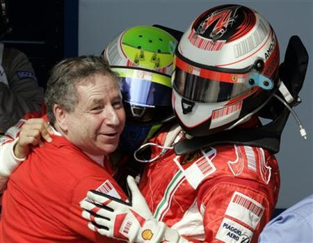 Ferrari Formula One driver Kimi Raikkonen (R) of Finland embraces team mate Felipe Massa and team director Jean Todt (L) after the Brazilian Grand Prix in Sao Paulo October 21, 2007 file photo. REUTERS/Paulo Whitaker