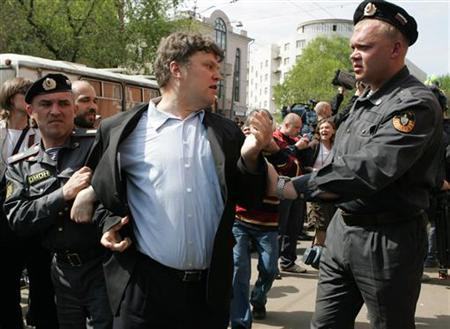 Police detain Sergei Mitrokhin, the leader of the small pro-western Yabloko party, during a rally outside a court in Moscow in 2005. REUTERS/Konstantin Koutsyllo