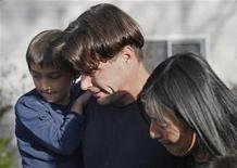 <p>Richard Heene (C), his wife Mayumi (R) and son six-year-old Falcon Heene talk to reporters in Fort Collins, Colorado, October 15, 2009. REUTERS/Rick Wilking</p>
