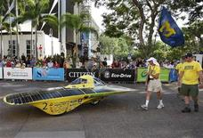 <p>Infinium, the Michigan University developed solar vehicle, makes its way to the start of the 2009 Global Green Challenge at the state square in Darwin October 25, 2009. The event from Darwin to Adelaide highlights the environmentally friendly production of alternative fuels,hybrid and experimental vehicles. REUTERS/Regi Varghese (AUSTRALIA ENVIRONMENT TRANSPORT ENERGY)</p>