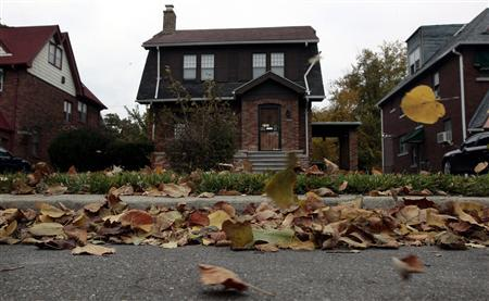 Fall leaves blow past an empty home seen in a well kept neighborhood where the house is listed on the auction block during the Wayne County tax foreclosures auction of almost 9,000 properties in Detroit, Michigan, October 22, 2009. REUTERS/Rebecca Cook