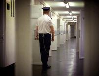 <p>A prison guard in a file photo. REUTERS/File</p>