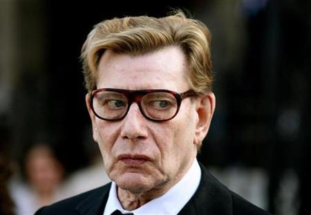 French fashion designer Yves Saint Laurent walks outside the Sainte Clothilde Church after funeral services for Lugi d'Urso, the late husband of French designer Ines de la Fressange, in Paris March 27, 2006.