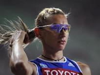<p>Греческая атлетка Фани Халкиа на чемпионате мира по атлетике в Осаке 28 августа 2007 года.Участие в эстафете олимпийского огня Игр 2010 года, которые пройдут в канадском Ванкувере, приняла бывшая олимпийская чемпионка Греции Фани Халкиа, на данный момент дисквалифицированная за употребление допинга. REUTERS/Dylan Martinez</p>