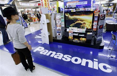 A woman looks at a Panasonic TV set at an electronics shop in Tokyo October 30, 2009. REUTERS/Kim Kyung-Hoon