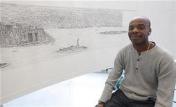 <p>British artist Stephen Wiltshire works on a hand drawn panorama of the skyline of New York, from a studio in Brooklyn at the Pratt Institute, October 28, 2009. REUTERS/Chip East</p>