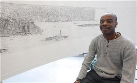 British artist Stephen Wiltshire works on a hand drawn panorama of the skyline of New York, from a studio in Brooklyn at the Pratt Institute, October 28, 2009. REUTERS/Chip East