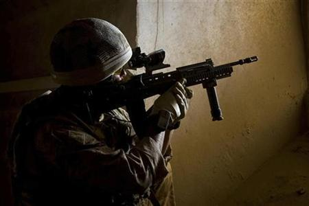 A handout photograph from the Royal marines shows a member of 42 Commando during Operation Aabi Toorah (Blue Sword) in Helmand province in southern Afghanistan in an image released March 19, 2009. REUTERS/MOD/Crown Copyright/Handout
