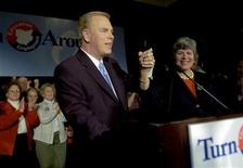 <p>Ted Strickland (L) celebrates with his wife Frances in downtown Columbus, Ohio, November 7, 2006. REUTERS/John Sommers II</p>