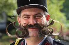 <p>Frenchman Herve Diebolt, a participant of the international World Beard and Moustache Championships smiles in Gruendau near Frankfurt September 19, 2009. Over 160 participants compete in 17 categories of beard and moustache styles. REUTERS/Ralph Orlowski</p>