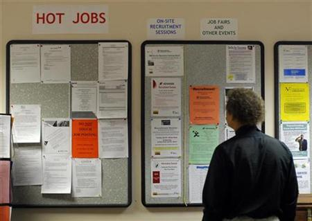 Librarian Gary Klein looks at the jobs and other announcements posted at The Work Place, which provides comprehensive employment and career services, in Boston, Massachusetts July 2, 2009. REUTERS/Brian Snyder