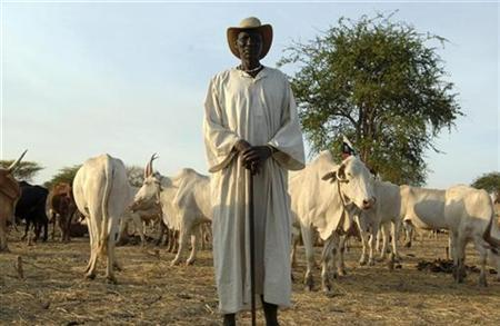 A Dinka man poses for a photograph as he herds his cattle at a camp in Abyei, southern Sudan, in this picture released by the United Nations Mission in Sudan (UNMIS) on March 13, 2009. REUTERS/Tim McKulka/UNMIS/Handout