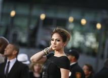 """<p>Actress Jennifer Lopez poses at the premiere of the documentary """"This Is It"""" in Los Angeles October 27, 2009. REUTERS/Mario Anzuoni</p>"""