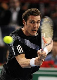 Marat Safin of Russia returns the ball to Thierry Ascione of France during their match in the Paris Masters Series tennis tournament November 9, 2009. REUTERS/Jacky Naegelen