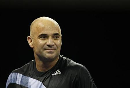 Andre Agassi of the U.S. looks on during an exhibition tennis match against compatriot Pete Sampras at Venetian Macao in Macau October 25, 2009. REUTERS/Bobby Yip
