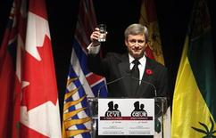 <p>Canada's Prime Minister Stephen Harper raises his glass in a toast during the True Patriot Love Tribute Dinner and gala in support of the Canadian Military Families fund in Toronto November 10, 2009. REUTERS/Mark Blinch</p>