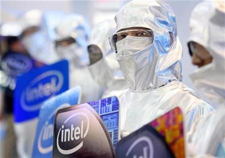 Men dressed in laboratory suits pose at the Intel booth during the 2009 Computex exhibition in Taipei June 2, 2009. REUTERS/Nicky Loh