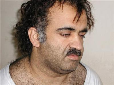 Khalid Sheikh Mohammed is shown in this file photograph during his arrest on March 1, 2003. Mohammed, the accused mastermind of the September 11, 2001 attacks on the United States, and four other top terrorism suspects held at Guantanamo Bay, Cuba will be sent to New York to be tried in a criminal court, U.S. Attorney General Eric Holder said on November 13, 2009. REUTERS/Courtesy U.S.News & World Report/Files